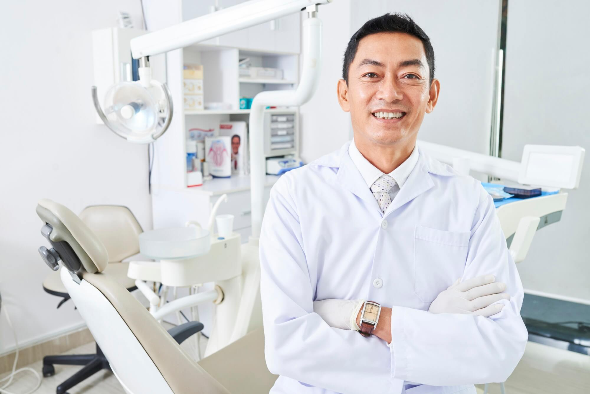 Cheerful Dentist With Arns Crossed